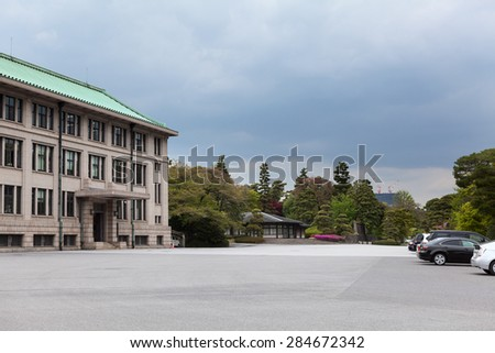 TOKYO, JAPAN - CIRCA APR, 2013: Car parking area is near Imperial Household Agency building at inner area of Tokyo Imperial Palace. Tokyo Imperial Palace is the main residence of the Emperor of Japan