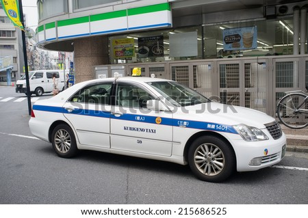TOKYO, JAPAN - CIRCA August, 2014:  Various luxurious car models are used as taxis in Japan. Toyota Crown pictured.