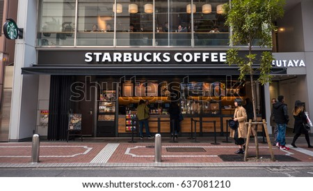 TOKYO, JAPAN - CIRCA MARCH, 2017: Starbucks coffee shop on the street. Starbucks is the largest coffeehouse company in the world.