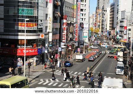 TOKYO, JAPAN - DECEMBER 28, 2011: Typical view of busy street in central Tokyo