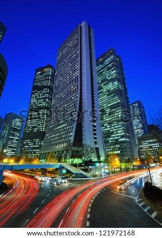 Tokyo, Japan intersection and skyscrapers cityscape in Nishi-Shinjuku skyscraper business district.