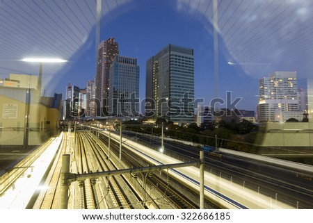 TOKYO, JAPAN - JANUARY 4 : Urban view of Tokyo by night with Shinkansen fast train at night. Japan 2013