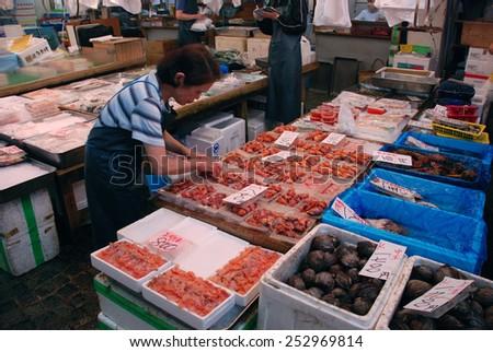 TOKYO, JAPAN - JULY 22 : Seafood sale at Tsukiji Market, the biggest wholesale market in Japan taken July 22, 2008 in Tokyo, Japan.