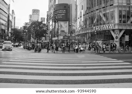 TOKYO, JAPAN - JULY 21: Shibuya crossing is one of the most famed examples of a scramble crosswalk in the world on July 21, 2011 in Tokyo, Japan.
