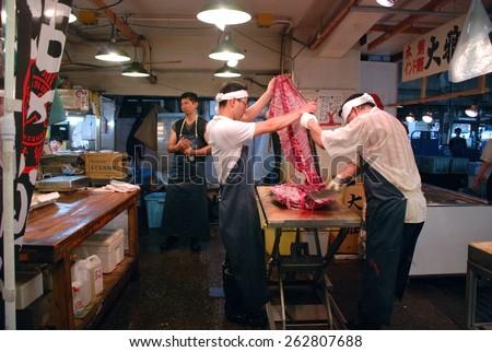 TOKYO, JAPAN - JULY 22 : Tuna fish cutting at Tsukiji Market, the biggest wholesale market in Japan taken July 22, 2008 in Tokyo, Japan.