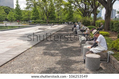 TOKYO,JAPAN-JULY 5:Unidentified people painting in the park of the Imperial Palace on the July 5,2011 in Tokyo,Japan.The Imperial Palace is only accessible by guided tour only in Japanese.