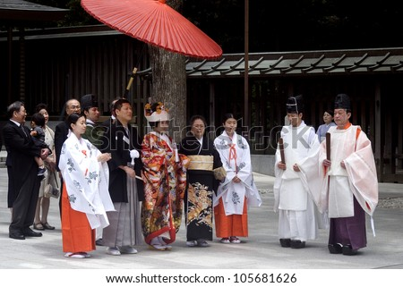 TOKYO, JAPAN - JUNE 20: Shinto wedding takes place at Meiji Shrine at June 20, 2012 in Tokyo, Japan. Most of the Japanese have Shinto wedding and Buddhist funeral to respect both religion.