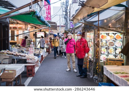 Tokyo, Japan - March 03, 2015: Famous Tsukiji fish market shops. Tsukiji is the biggest fish market in the world, with a vast varaiety of Fish and Sea food