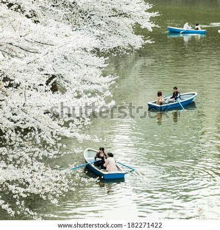 Tokyo, Japan - March 23, 2013: Japanese people paddling boats in river to see Sakura blossom at Kudanshita, Tokyo, Japan