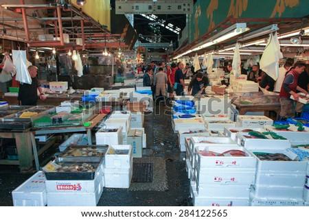 Tokyo, Japan - May 11, 2015: Famous Tsukiji fish market shops. Tsukiji is the biggest fish market in the world, with a vast varaiety of Fish and sea food