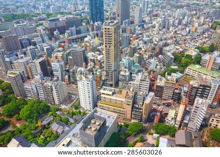 TOKYO, JAPAN - MAY 10, 2012: Modern cityscape view in Tokyo, Japan. Tokyo is the capital city of Japan and the most populous metropolitan area in the world with almost 36 million people.