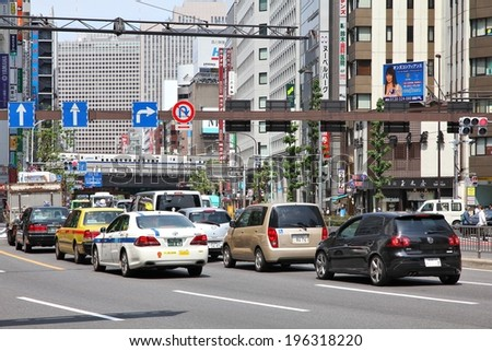 TOKYO, JAPAN - MAY 11, 2012: People drive cars in Tokyo. With 591 vehicles per capita, Japan is a country with one of highest car ownership rates.