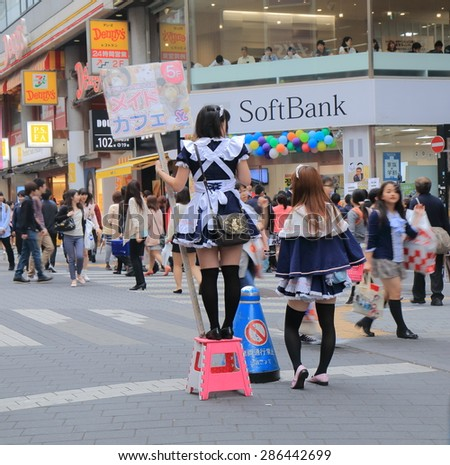 TOKYO JAPAN - MAY 9, 2015: Unidentified girls promote maid cafe in Ikebukuro. Maid cafe is a cosplay restaurant where waitresses dressed in maid costumes.