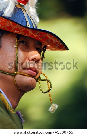TOKYO, JAPAN - NOVEMBER 3: Traditional Japanese horseman looks on during a festival of the birthday of Emperor Meiji, November 3, 2009 in Tokyo, Japan.