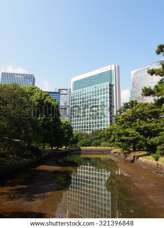 TOKYO, JAPAN - SEP 28: Hamarikyu Gardens and modern buildings in Tokyo, Japan on September 28, 2015. Tokyo is both the capital and largest city of Japan.