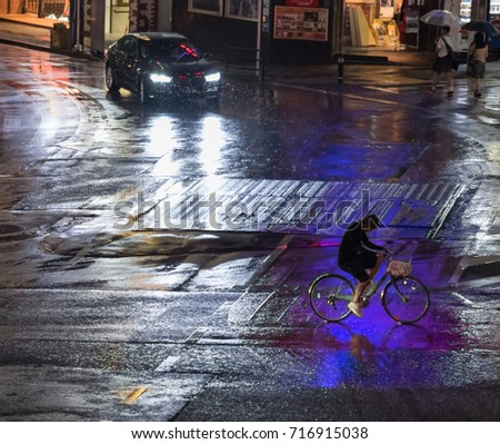 TOKYO, JAPAN - SEPTEMBER 16TH, 2017. Vehicles in Shibuya street on a dark rainy night. #716915038