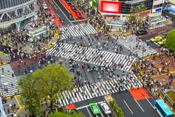 Tokyo, Japan view of Shibuya Crossing, one of the busiest crosswalks in the world.