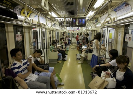 TOKYO- JULY 3: Commuters ride Tokyo metro transit system in Tokyo, Japan on July 3, 2011. The transit system carries 8.7 million passengers per day and began operations on December 30, 1927.