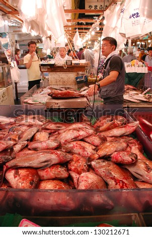 TOKYO - JULY 17 : Fish seller at Tsukiji Market, the biggest wholesale market in Japan, market will  be moved to new location in 2014, July 17, 2008 in Tokyo, Japan.