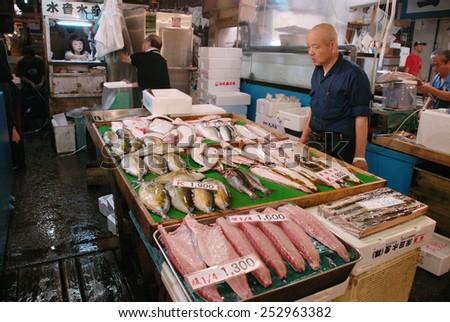 TOKYO - JULY 19 : Fish seller at Tsukiji Market, the biggest wholesale market in Japan taken July 19, 2008 in Tokyo, Japan.