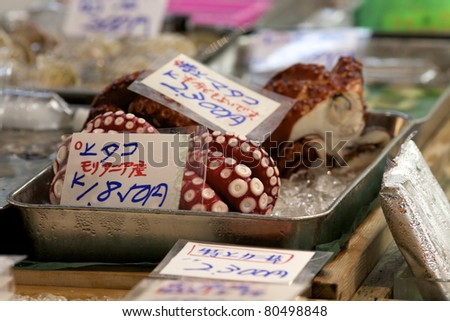 TOKYO- JULY 4: Fresh octopus on sale at the Tsukiji Wholesale Seafood and Fish Market in Tokyo Japan on July 4, 2011. Tsukiji Market is the biggest wholesale fish and seafood market in the world.