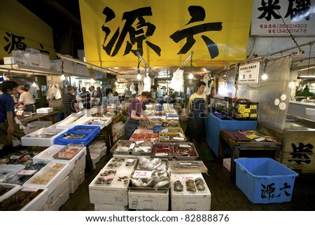 TOKYO - JULY 4: Seafood vendors at the Tsukiji Wholesale Seafood and Fish Market in Tokyo Japan on July 4, 2011. Tsukiji Market is the biggest wholesale fish and seafood market in the world.