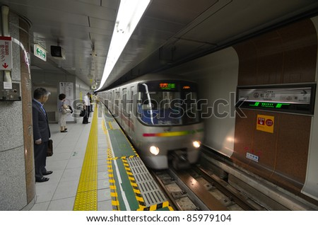 TOKYO - JULY 5: Train arrives on the Oedo Line at Tochomae Station July 5, 2011 in Tokyo, Japan. The line is Tokyo\'s first linear motor metro line.