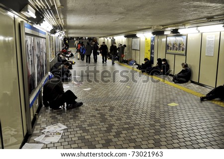 TOKYO - MAR 11: People spending the night in the subway on March 11, 2011 in Tokyo, Japan. Millions of people can't get home as all trains and subway trains have stopped because of the earthquake.