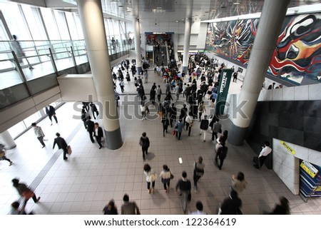 TOKYO - MAY 9: Commuters hurry at Tokyo Shibuya station on May 9, 2012 in Tokyo. With 2.4 million passengers on a weekday, it is the 4th-busiest commuter rail station in Japan.