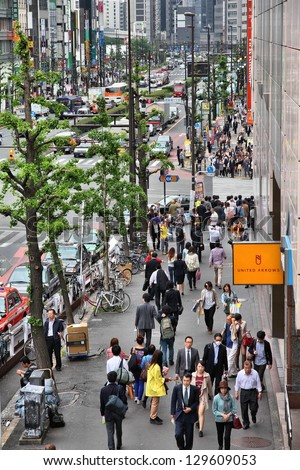 TOKYO - MAY 8: Commuters hurry on May 8, 2012 in Shinjuku district, Tokyo. Shinjuku is one of the busiest districts of Tokyo, with many international corporate headquarters located here.