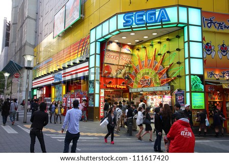 TOKYO - MAY 11: People visit Sega Ikebukuro arcade game centre on May 11, 2012 in Tokyo. Sega is a profitable company with US $4.9 billion revenue in 2011. It exists since 1940.