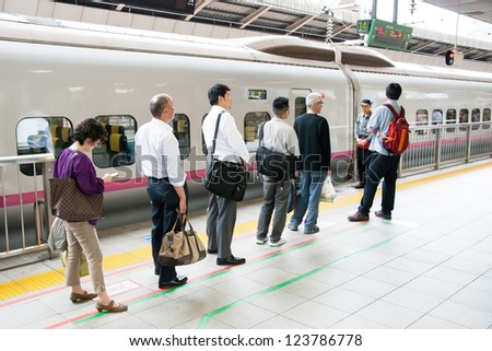 TOKYO - MAY 20, 2012: People waiting for shinkansen bullet train at Tokyo main railway station in May 20, 2012 Tokyo, Japan.Shinkansen is world's busiest high-speed railway on the world.