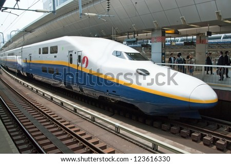TOKYO - MAY 17, 2012: Shinkansen bullet train at Tokyo railway station in May 17, 2012 Tokyo, Japan. Shinkansen is world's busiest high-speed railway operated by four Japan Railways companies.