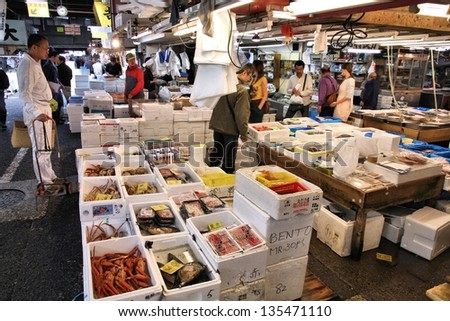 TOKYO - MAY 11: Shoppers visit Tsukiji Fish Market on May 11, 2012 in Tokyo. It is the biggest wholesale fish and seafood market in the world.