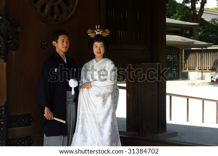 TOKYO - MAY 31: Wedding of a young Japanese couple dressed in traditional clothes at Meiji Jingu May 31, 2009 in Tokyo. Meiji Jingu shrine is a famous wedding location for young couples.