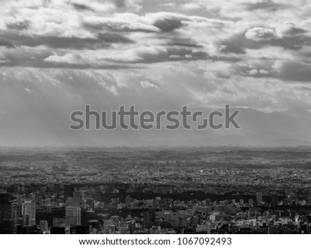 Tokyo metropolis with sun ray. In Black and White