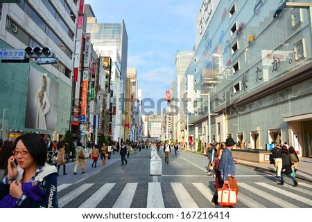 TOKYO - 10 November 2013 Ginza road in the weekend. One of the famous shopping street in Tokyo, Japan. On the weekend, this road will became a walking street for shopping and street performances