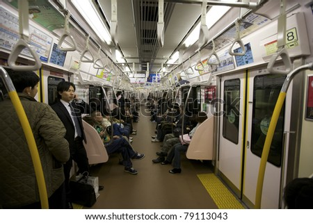 TOKYO- NOVEMBER 17: Rush hour commuters riding the Tokyo metro transit system in Tokyo, Japan on November 17, 2009.  The transit system carries almost an average of 8 million passengers daily.
