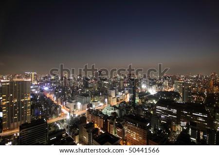 Tokyo skyline light up during sunset