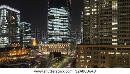 Tokyo station and cityscape with tall office buildings at night #324800648