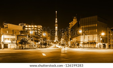 Tokyo street at night with car trail