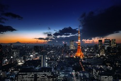 Tokyo tower with Fuji mountain in sunset background. building landmark of Tokyo city. cityscape at twilight time. aerial view of skyscraper night life in japan