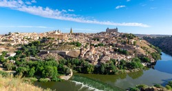 Toledo city in Spain whole cityscape from the hill with blue sky.