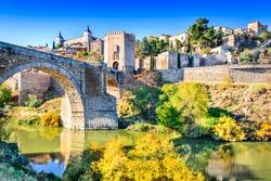 Toledo, Spain. Alcazar and Alcantara Bridge ( Puente de Alcantara), an arch bridge in Toledo, spanning the Tagus River.