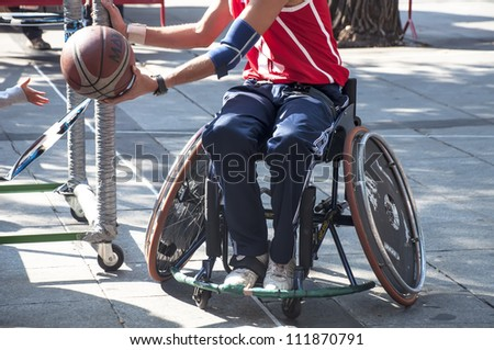 TOLEDO, SPAIN, OCTOBER 1: unidentified man play a friendly game of wheelchair basketball, one of the activities in the Youth Week on October 1, 2011 in Toledo, Spain