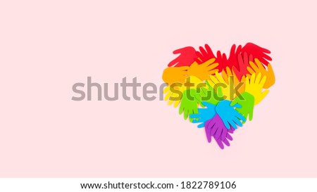 Tolerance, kindness, cooperative, friendship, charity humanitarian aid day concept. Many rainbow color palm hands on pink background with copy space. Stock fotó ©