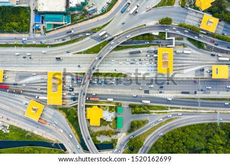 Toll expressway and motorway payment point, Road traffic an important infrastructure. multilevel junction, Aerial top view of Road and Roundabout