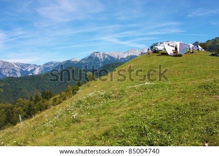 TOLMIN, SLOVENIA - AUGUST 20: Hang gliders standing on start in  the Kobala Open-2011 hang gliding competitions on August 20, 2011 near Tolmin, Slovenia.