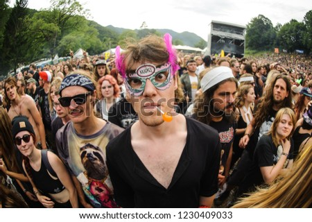 Tolmin, Slovenia - July 26th 2017: Crazy metal fans having a a party of their life during performance of a Czech metal band Gutalax on stage at Metaldays Festival #1230409033