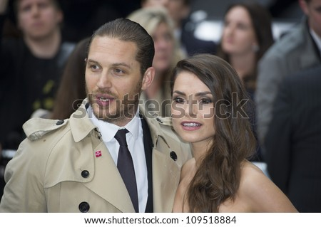 """Tom Hardy and Charlotte Riley arriving for European premiere of """"The Dark Knight Rises"""" at the Odeon Leicester Square, London. 18/07/2012 Picture by: Simon Burchell / Featureflash"""